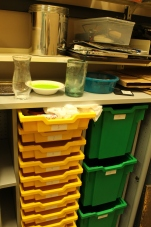 Storage bins for student projects in the office.