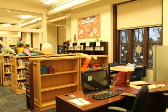The circulation desk is now at the other end of the library, right outside the office.