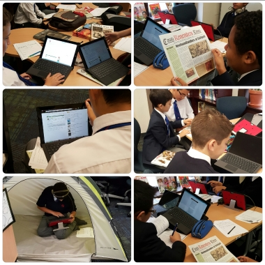 """Grade 7s hard at work in the """"explore"""" stage of guided inquiry."""