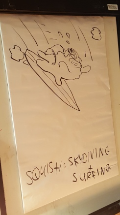 We were treated to a live drawing session! Here's Squish skydiving AND surfing at the same time.